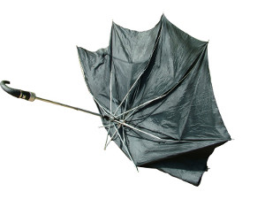 The black classic umbrella broken by the wind gust